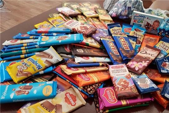 Стать волшебником может каждый: в Калининском районе проходит акция «Шоколадное чудо в мешок Деда Мороза»