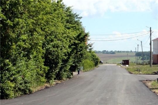На дороге по ул. Парковая с. Моргауши продолжается ремонт в рамках национального проекта «Безопасные и качественные автомобильные дороги»